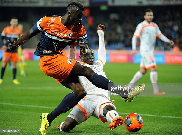 Montpellier's French forward Mbaye Niang vies for the ball with Valenciennes' Senegalese defender Saliou Ciss during the French L1 football match...