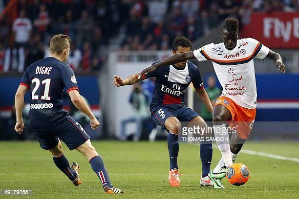 Montpellier's French forward Mbaye Niang vies with Paris' Brazilian defender Marquinhos and Paris' French defender Lucas Digne during the French L1...