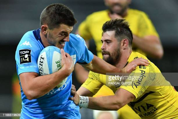 Montpellier's French full back Anthony Bouthier vies with La Rochelle's French wing Arthur Retiere during the French Top 14 rugby union match between...