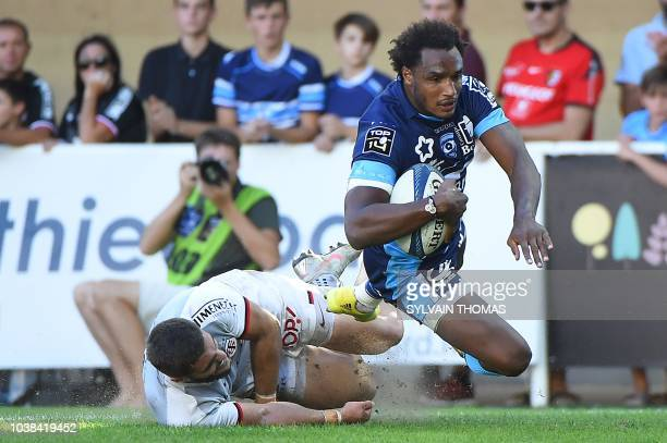 Montpellier's French fullback Benjamin Fall dives to scores a try during the French Top 14 rugby union match between Montpellier and Toulouse at The...