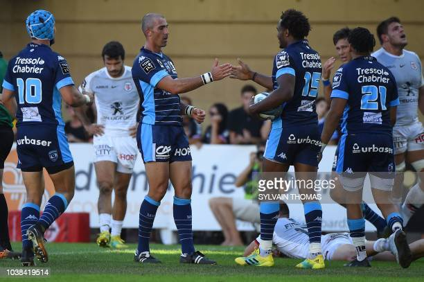 Montpellier's French fullback Benjamin Fall is congratulated by Montpellier's French scrumhalf Ruan Pienaar after scoring a try during the French Top...