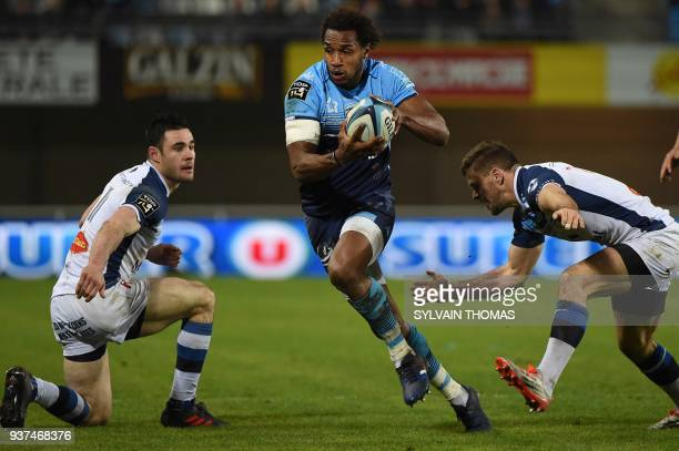 Montpellier's French fullback Benjamin Fall runs with the ball during the French Top 14 rugby union match between Montpellier and Castres on March 24...