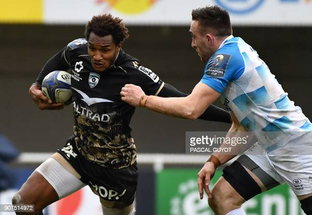 Montpellier's French fullback Benjamin Fall tries to break away with Leinster's Irish flanker Jack Conan during the European rugby champions cup...