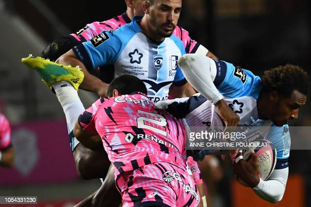 TOPSHOT Montpellier's French fullback Benjamin Fall vies with Stade Francais Paris' French hooker Laurent Panis during the French Top 14 rugby union...