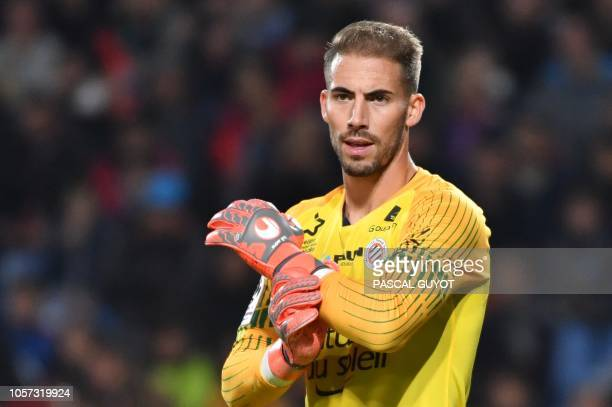 Montpellier's French goalkeeper Benjamin Lecomte reacts during the French L1 football match between Montpellier and Marseille at the the Mosson...