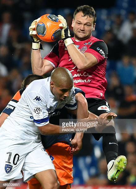 Montpellier's French goalkeeper Laurent Pionnier grabs the ball ahead of Bastia's Tunisian midfielder Wahbi Khazri during the French L1 football...