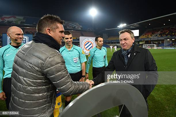 Montpellier's French head coach Frederic Hantz shakes hands with Bordeaux's French head coach Jocelyn Gourvennec before the French L1 football match...