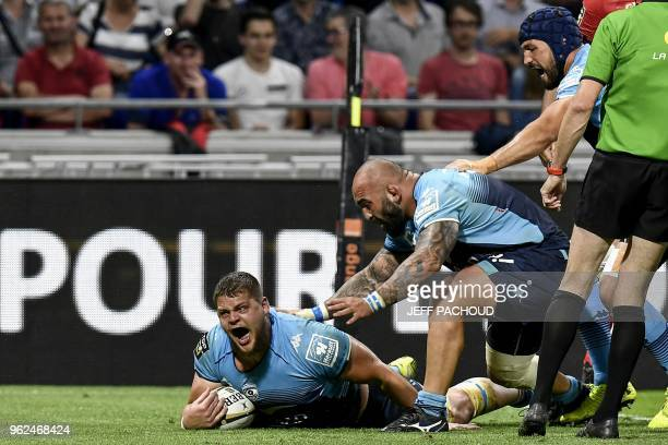 Montpellier's French lock Paul Willemse celebrates as he scores a try during the French Top 14 union semi-final rugby match between Montpellier and...