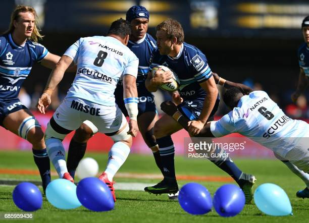 Montpellier's French lock Paul Willemse vies with Racing Metro 92 New Zealand Number Eight Chris Masoe and Racing Metro 92 French flanker Yannick...