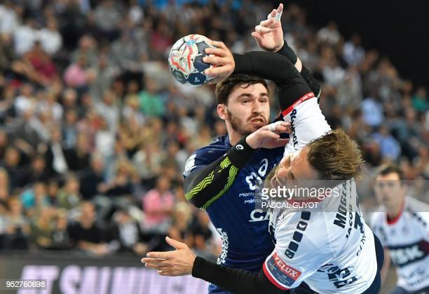 Montpellier's French Ludovic Fabregas vies with Flensburg's Danish central back Thomas Mogensen during the EHF Champions League quarterfinal handball...