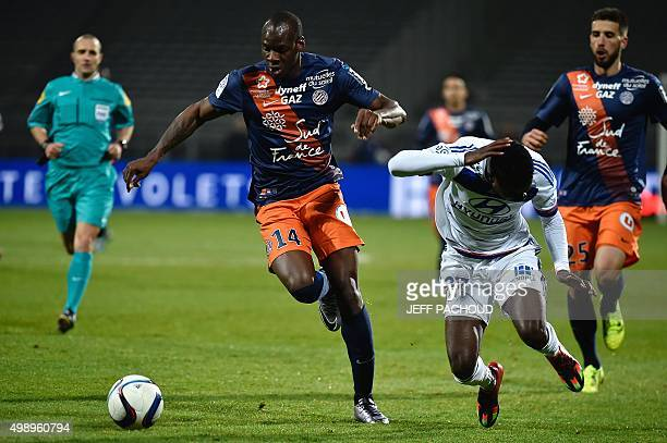 Montpellier's French midfielder Bryan Dabo vies for the ball with Lyon's French forward Maxwel Cornet during the French L1 football match between...