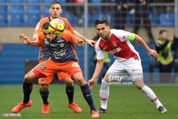 Montpellier's French midfielder Ellyes Skhiri heads a ball next to Monaco's Colombian forward Falcao during the French L1 football match between...