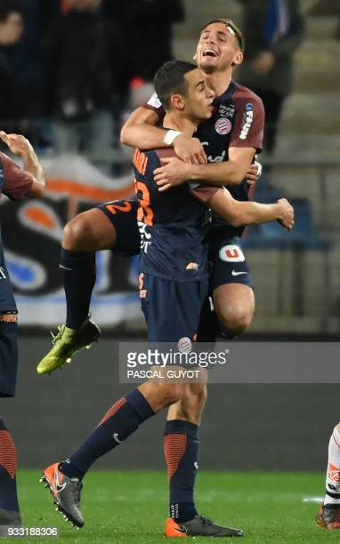 Montpellier's French midfielder Ellyes Skhiri is congratulated by his teammate Montpellier's French defender Ruben Aguilar after scoring a goal...