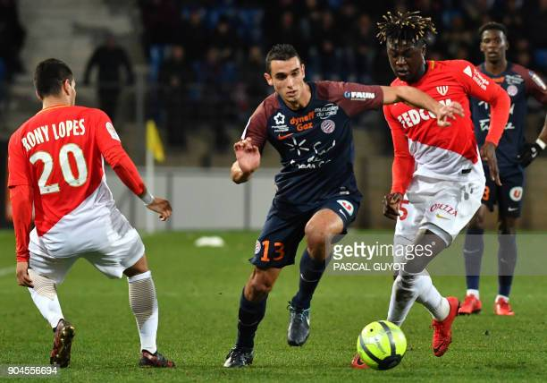 Montpellier's French midfielder Ellyes Skhiri vies with Monaco's French defender Kevin Ndoram and Monaco's Brazilian midfielder Rony Lopez during the...
