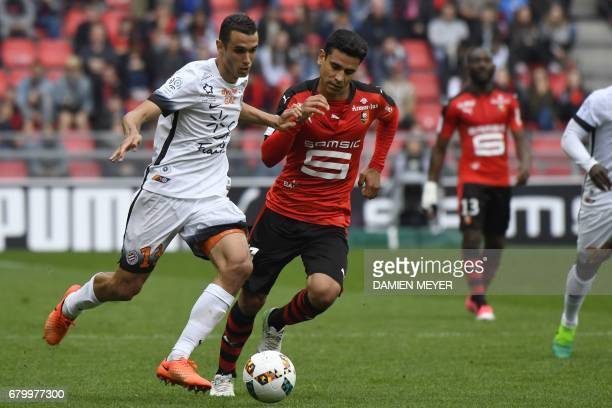 Montpellier's French midfielder Ellyes Skhiri vies with Rennes' French midfielder Benjamin Andre during the French L1 football match between Rennes...
