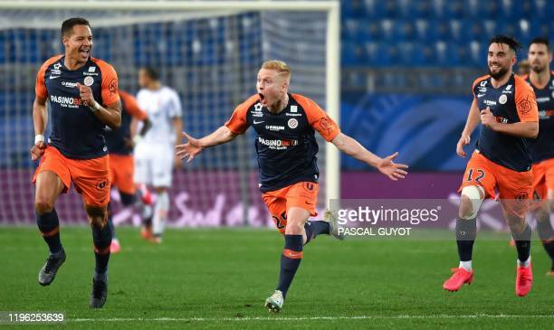 Montpellier's French midfielder Florent Mollet reacts after scoring a goal during the French L1 football match between Montpellier Herault SC and...