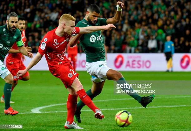 Montpellier's French midfielder Florent Mollet vies with SaintEtienne's French midfielder Youssef Ait Bennasser during the French L1 football match...