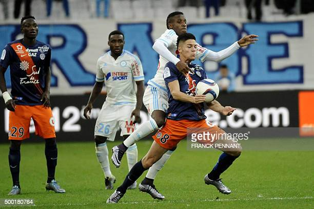 Montpelliers French midfielder Jonas Martin vies with Marseille's Guinean midfielder Bouna Sarr during the French L1 football match Olympique de...