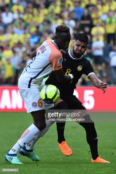 Montpellier's French midfielder Junior Sambia vies with Nantes' Brazilian defender Lima during the French L1 football match Nantes vs Montpellier on...