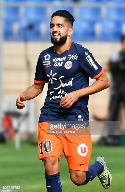 Montpellier's French midfielder Ryad Boudebouz reacts after scoring a goal during the French L1 football match between Montpellier and Nice on...