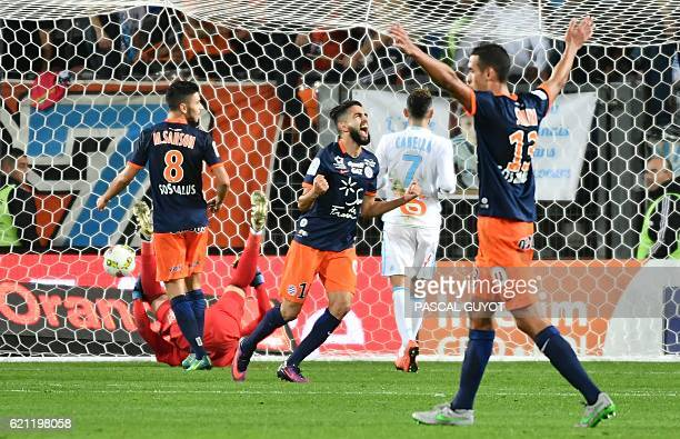 Montpellier's French midfielder Ryad Boudebouz reacts after scoring a goal during the French L1 football match between MHSC Montpellier and Olympique...