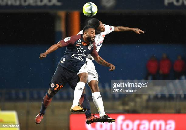 Montpellier's French midfielder Stephane Sessegnon vies with Amien's SouthAfrican midfielder Bongani Zungu during the French L1 football match...