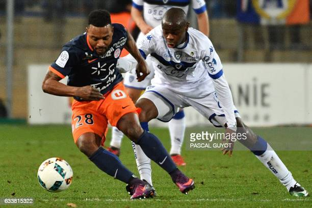 Montpellier's French midfielder Stephane Sessegnon vies with Bastia's French midfielder Prince Oniangue during the French L1 football match between...