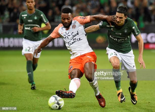 Montpellier's French midfielder Stephane Sessegnon vies with SaintEtienne's French midfielder Vincent Pajot during the French L1 football match...