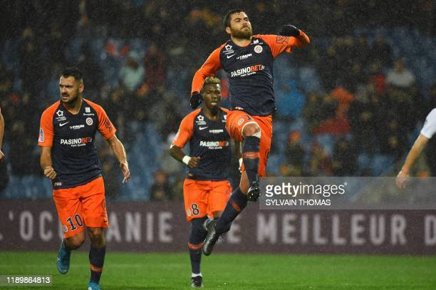 Montpellier's French midfielder Teji Savanier celebrates after scoring a goal from the penalty kick during the French L1 football match between...