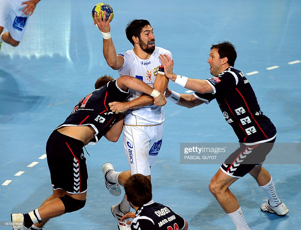 Montpellier's French Nikola Karabatic (C) vies with Flensburg's Tobias Karlsson (R) and Jacob Heinl (L) during the Champions League handball match Montpellier AHB vs SG Flensburg-Handewitt, on December 2, 2012 at the Arena hall in Montpellier, southern France. Flensburg won 27-25.