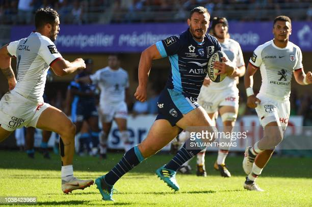 Montpellier's French number 8 Louis Picamoles runs with the ball prior to scoring a try during the French Top 14 rugby union match between...
