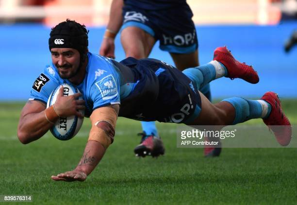 Montpellier's French number eight Alexandre Dumoulin scores a try during the French Top 14 rugby union match between Montpellier and Agen at The...