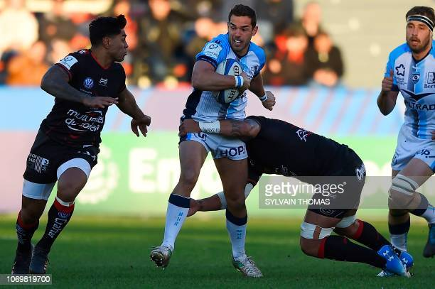 Montpellier's French number eight Vincent Martin runs with the ball during the European Rugby Champions Cup union match between Toulon and...