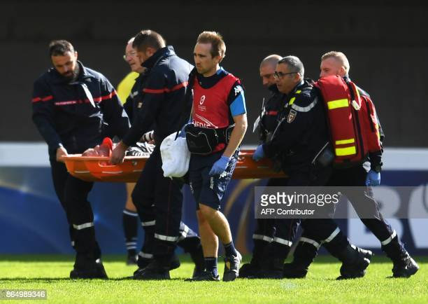 Montpellier's French scrumhalf Ruan Pienaar is evacuated from the pitch on a stretcher after being wounded during the European Champions Cup rugby...