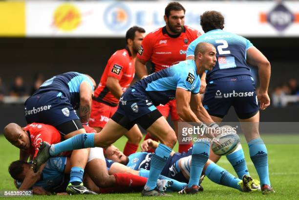 Montpellier's French scrumhalf Ruan Pienaar passes the ball during the French Top 14 rugby union match between Montpellier and Toulon on September 17...