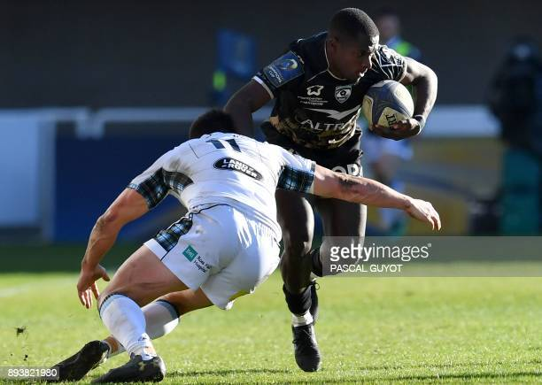 Montpellier's French winger Gabriel Ngambede vies with Glasgow's Scottish winger Lee Jones during the European rugby champions cup match between...