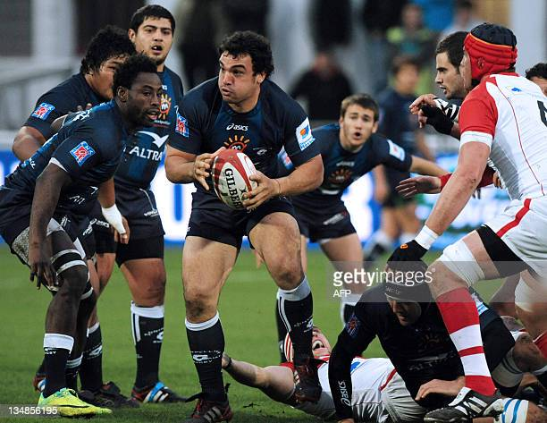 Montpellier's hooker Agustin Creevy holds the ball during the French Top 14 rugby union match Biarritz vs. Montpellier at the Aguiléra stadium in...