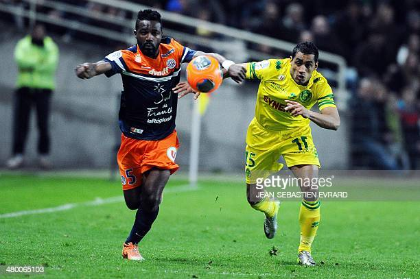 Montpellier's Ivoirian defender Siaka Tiene vies with Nantes' Romanian midfielder Banel Nicolita during the French L1 football match between FC...