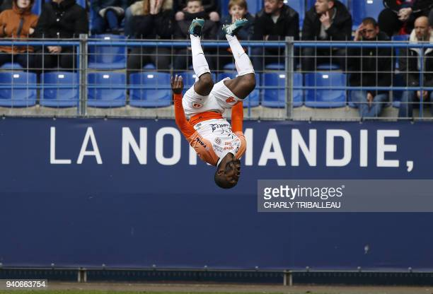 TOPSHOT Montpellier's Ivorian forward Giovanni Sio celebrates after scoring a goal during the French L1 football match between Caen and Montpellier...