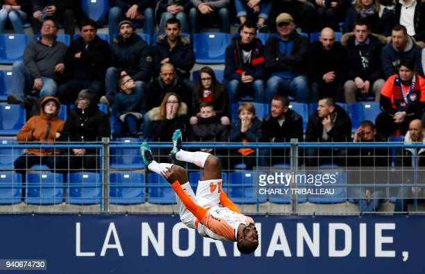 Montpellier's Ivorian forward Giovanni Sio celebrates after scoring a goal during the French L1 football match between Caen and Montpellier at The...