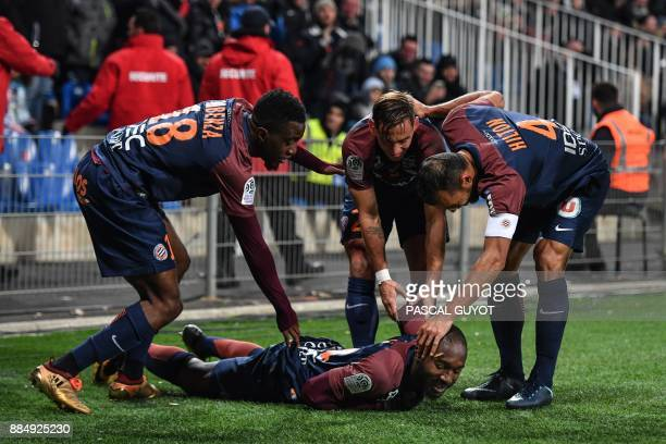 Montpellier's Ivorian forward Giovanni Sio celebrates with Montpellier's French forward Isaac Mbenza Montpellier's French defender Ruben Aguilar and...