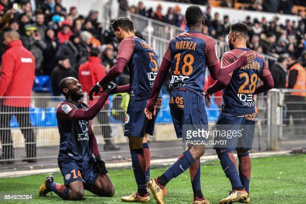 Montpellier's Ivorian forward Giovanni Sio celebrates with Montpellier's Portuguese defender Pedro Mendes Montpellier's French forward Isaac Mbenza...