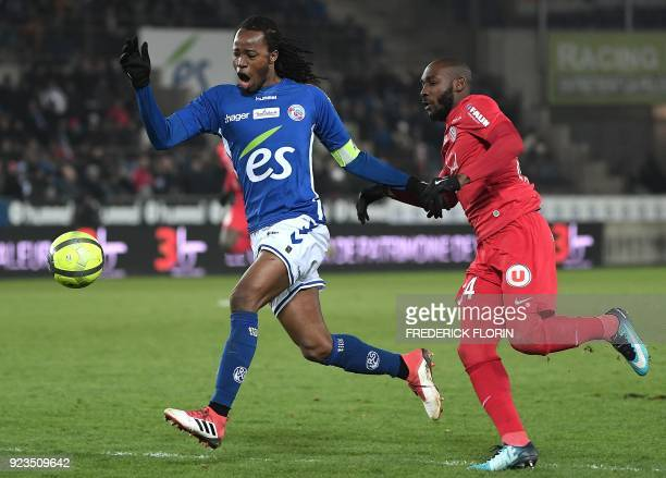 Montpellier's Ivorian forward Giovanni Sio fights for the ball with Strasbourg's Burkinabe defender Bakary Kone during the French L1 football match...