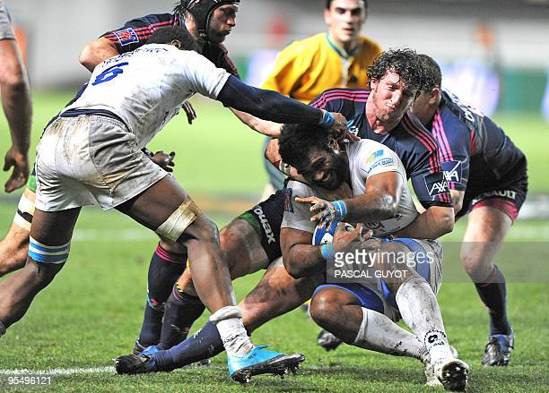 Montpellier's Masi Matadigo vies with Stade Français' Mauro Bergamasco during their French Top14 rugby union match on December 30 2009 at Yves...
