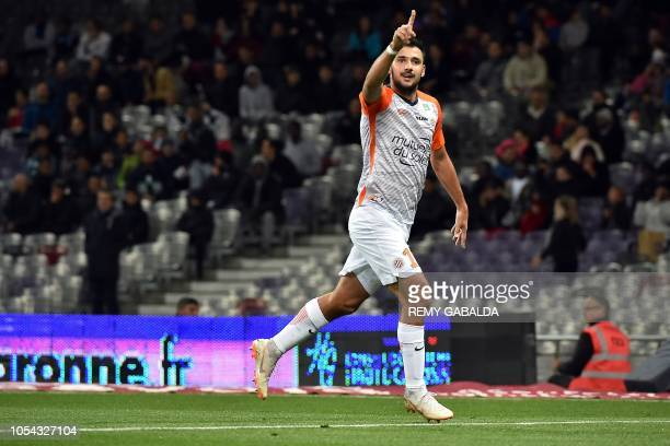 Montpellier's midfielder Gaetan Labordes celebrates after scoring a goal during the French L1 football match between Toulouse and Montpelier on...