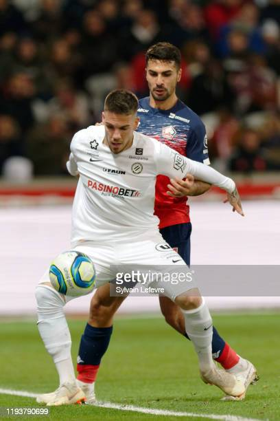 Montpellier's Mihailo Ristic and Lille's Zeki Celic during the Ligue 1 match between Lille OSC and Montpellier HSC at Stade Pierre Mauroy on December...