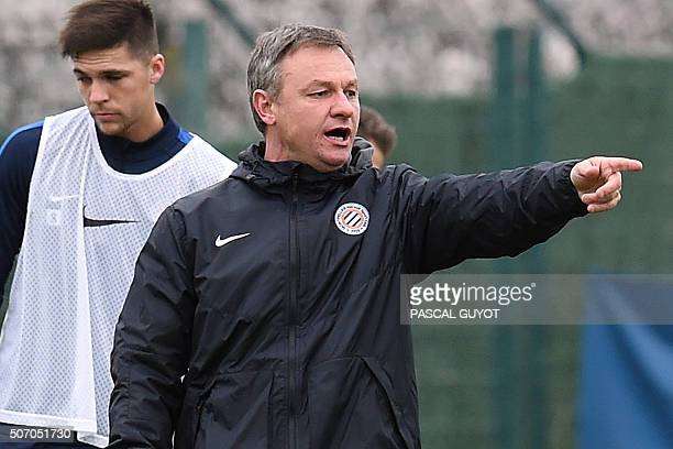 Montpellier's new French coach Frederic Hantz speaks to players during a training session at Grammont Stadium in the southern French city of...