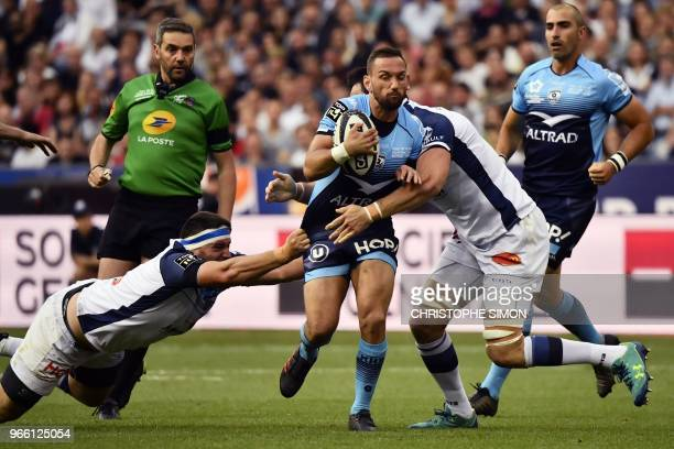 TOPSHOT Montpellier's New Zealander flyhalf Aaron Cruden is tackled during the French Top 14 final rugby union match between Montpellier and Castres...