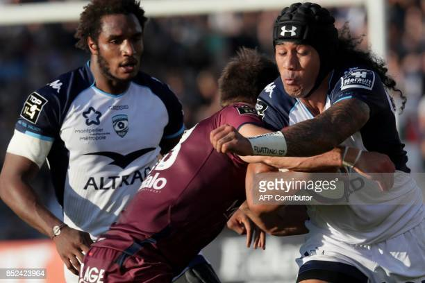 Montpellier's New Zealander winger Joe Tomane is tackled during the French Top 14 rugby union match between Union Bordeaux Begles and Montpellier on...