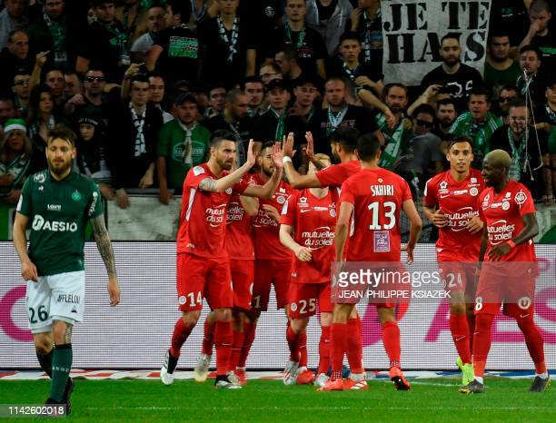 Montpellier's players celebrate after scoring a goal during the French L1 football match between SaintEtienne and Montpellier on May 10 at the...